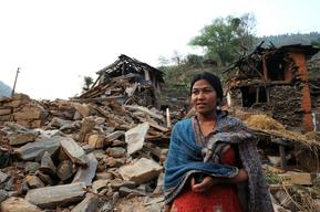 Female Community Health Volunteer (FCHV) Sarita Shrestha sets off from her damaged house