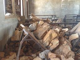 Classroom damaged/benches crushed - Maidi village, Dhadang District